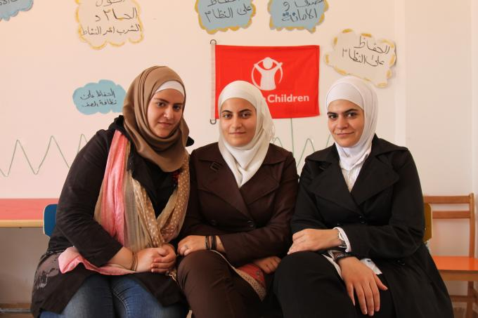 (L-R) Syrian sisters Fatma, Banan and Media Al Safady at Save the Children's Child Friendly Space in El-Obour, Greater Cairo, where they have helped facilitate children's activities since November 2013.